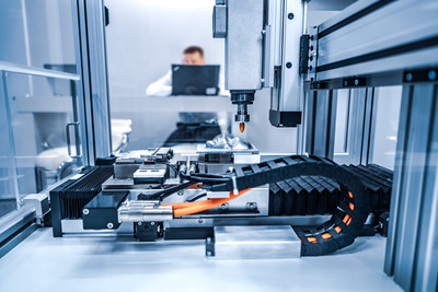 CNC Laser cutting of metal, modern industrial technology. Small depth of field. Warning - authentic shooting in challenging conditions.